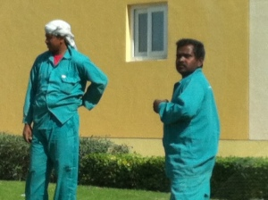 Landscapers working in our compound, in their regulation uniform