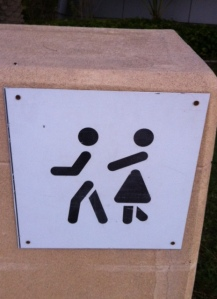 Despite what this sign might suggest, we don't have to walk behind our husbands!