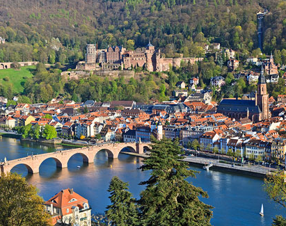 Green, tree-covered hills surround the beautiful medieval town of Heidelberg Germany