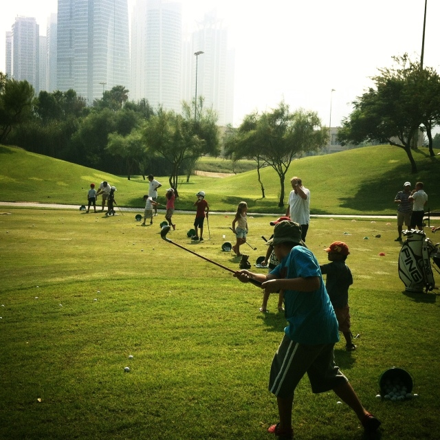 playing golf in Dubai