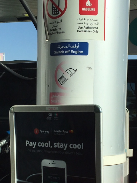 Dubai gas station phone sign